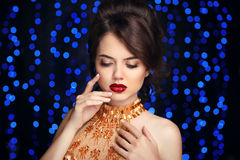 Makeup. Beautiful fashion woman in gold, elegant lady in expensi Stock Photo