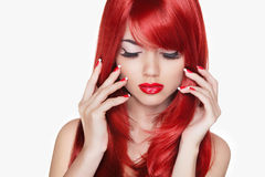 Makeup. Beautiful girl with red long hair. Fashion model isolate Royalty Free Stock Images