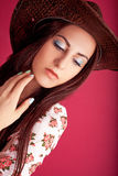 MakeUp. Beautiful girl showing teens fashion and modern makeup Royalty Free Stock Photos
