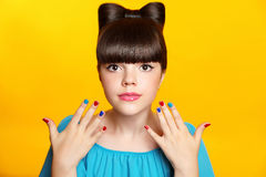 Makeup. Beautiful teen girl with bow hairstyle and multicolor ma Stock Image