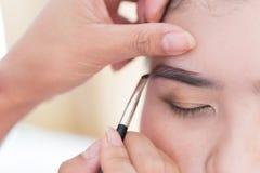 Makeup beauty with brush eyebrow Stock Photos
