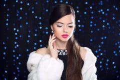 Makeup. Beauty Fashion Model Girl in white Mink Fur Coat. Elegan Stock Image