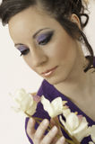 Makeup and Beauty Model. Fashion beauty and makeup model holding an orchid flower Royalty Free Stock Photography