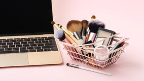 Free Makeup Beauty Online Shopping Concept With Cosmetic Products Stock Photography - 208805302
