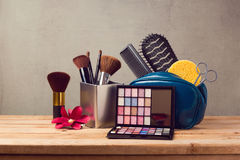 Makeup and beauty products on wooden table. Over gray background Royalty Free Stock Image