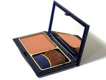 Makeup - Blush. Dark blue compact with blush and brush stock photography