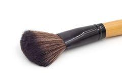Makeup borstar incup på vit bakgrund Arkivbilder