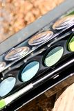 Makeup box by the lake on the sand Royalty Free Stock Photography