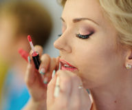 Makeup for bride on the wedding day Stock Images