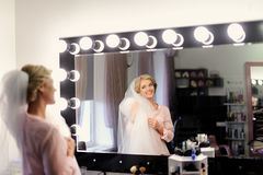 Makeup for bride on the wedding day Stock Image