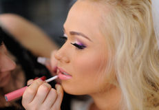 Makeup for bride on the wedding day Royalty Free Stock Photo