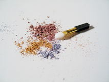 Makeup with Brush. Macro of crumbled multi-colored eyeshadows with a clean brush sitting in it stock photos