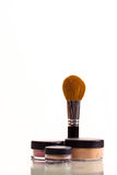 Makeup brush. With set of cosmetic pots on a white background royalty free stock photos