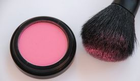 Makeup and Brush. A Cosmetic makeup brush with powder Royalty Free Stock Photos