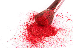Makeup brush background with blush sprinkled on white Stock Photo