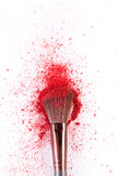 Makeup brush background with blush sprinkled on white Stock Image