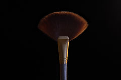 Makeup brush. On black background stock images