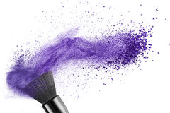 Makeup brush with blue powder isolated. On white Stock Image