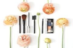 Makeup brush collection eye shadow and ranunculus flowers isolated on white background. Photo royalty free stock photos