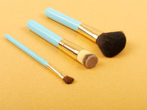Makeup brush and cosmetic blush. Royalty Free Stock Photography