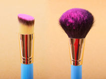 Makeup brush and cosmetic blush. Stock Image