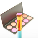 Makeup brush and cosmetic blush. Royalty Free Stock Photos