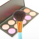 Makeup brush and cosmetic blush. Royalty Free Stock Images