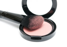 Makeup brush and cosmetic powder Stock Photography