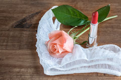 Makeup brush and cosmetics with thong Stock Images