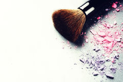 Makeup brush and crushed eyeshadows Royalty Free Stock Photo