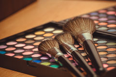 Makeup brush and eye shadow Stock Images