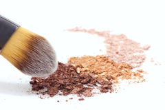 Makeup brush and eyeshadows. Makeup brush and multicolored eyeshadow on white background Royalty Free Stock Images