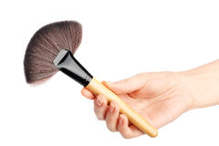Makeup brush in hand Royalty Free Stock Photography
