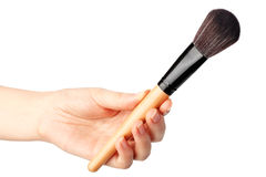 Makeup brush in hand Stock Photography