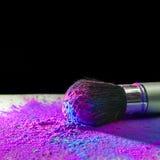 Makeup brush with holi paint Royalty Free Stock Image