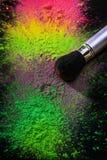 Makeup brush with holi paint Stock Photography