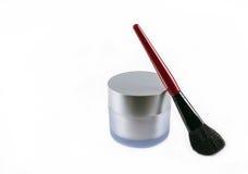 Makeup brush and a jar of face cream Stock Photo