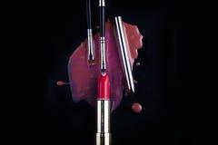 Makeup brush and lipstick Stock Photo