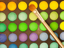 Makeup brush and make-up eye shadows palette Stock Image