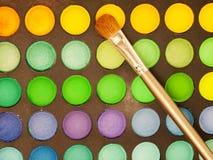 Makeup brush and make-up eye shadows palette Stock Image