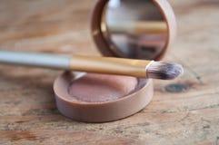 Makeup brush and miror closeup royalty free stock photography