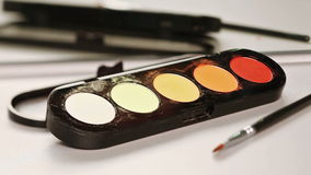 Makeup brush and multicolor eye shadows palette stock video footage