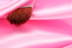 Makeup Brush On Pink Satin Stock Images