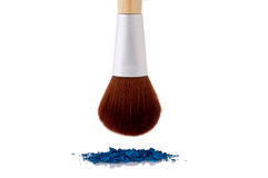 A makeup brush over blue makeup Royalty Free Stock Photos
