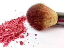 Makeup brush with pink blush powder on a white background. Close up of blush brush with pink blush powder isolated on a white surface stock photos