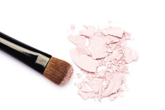 Makeup brush with pink eyeshadows. Isolated on white Royalty Free Stock Image