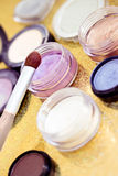 Makeup brush and plenty of eyeshadows. Make-up shot of some eyeshadows Royalty Free Stock Image