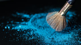 Makeup brush on professional cosmetic on background with colorfu Stock Photography