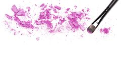 Makeup brush and purple eye shadow on white with space for text royalty free stock images