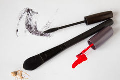 Makeup brush, red nail polish and mascara on white background Stock Photo